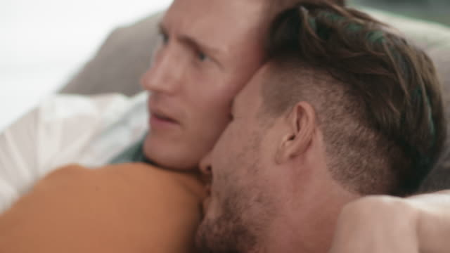 romance : cute male queer couple at home. - sports round stock videos & royalty-free footage