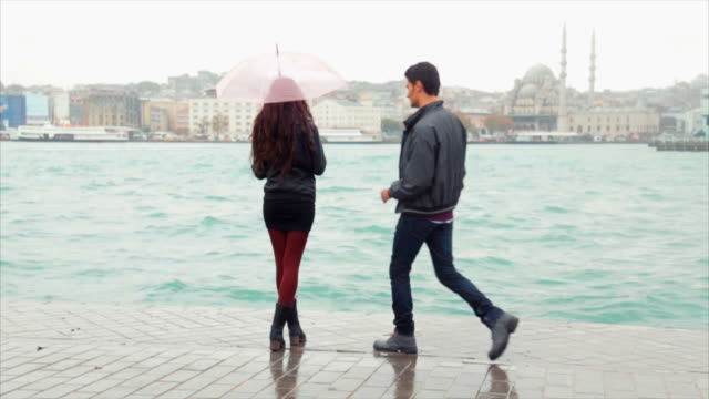 romance in the rain - picking up stock videos & royalty-free footage