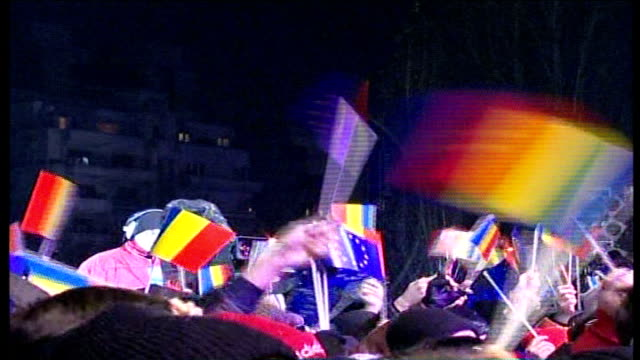 romania and bulgaria celebrate becoming members via reuters romania bucharest ext high angle shot fireworks exploding over revolution square people... - reuters stock videos & royalty-free footage
