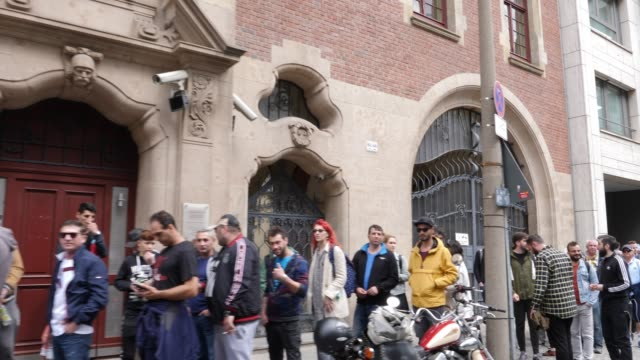 romanian citizens wait in long rows in front of the romanian embassy in berlin to vote here at a polling station in european parliamentary elections... - regierungsgebäude stock-videos und b-roll-filmmaterial