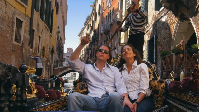 ms, romanic couple in gondola, venice, italy - canal stock videos & royalty-free footage