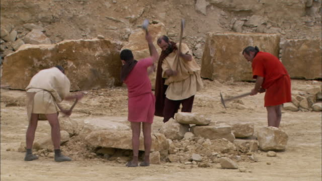 romans hew limestone blocks in a quarry. - reenactment stock videos & royalty-free footage