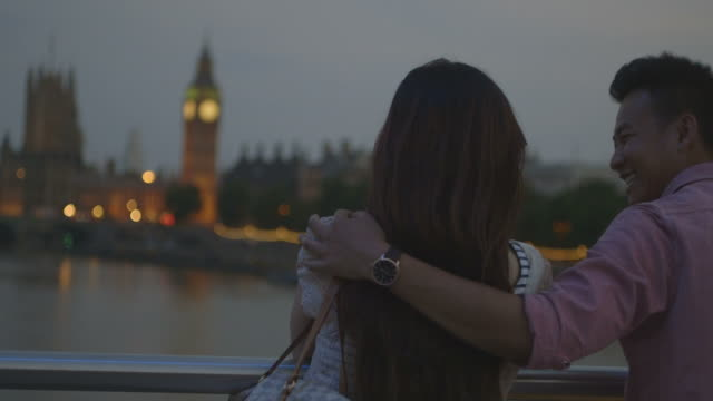 Romantic Asian Tourist couple standing on bridge