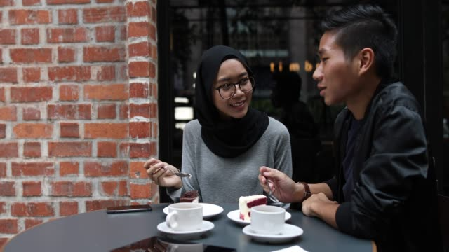 romantic chat in cafe - indonesian ethnicity stock videos & royalty-free footage