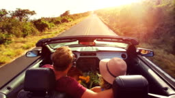 Romantic Convertible Drive into Sunset