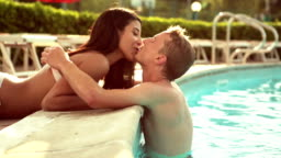 Romantic couple at the edge of pool
