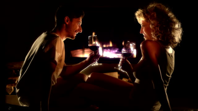 stockvideo's en b-roll-footage met romantic couple by the fireplace - romance