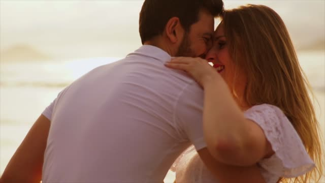 romantic couple embracing on the beach - boyfriend stock videos & royalty-free footage