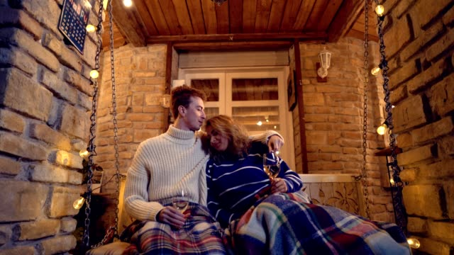 romantic couple enjoying glass of wine - front porch stock videos and b-roll footage