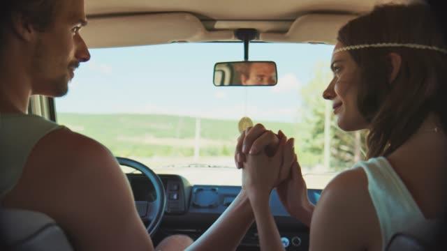 romantic couple enjoying road trip during summer - van vehicle stock videos & royalty-free footage
