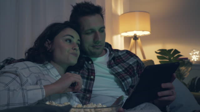 romantic couple enjoying watching movies at home. - couple relationship stock videos & royalty-free footage