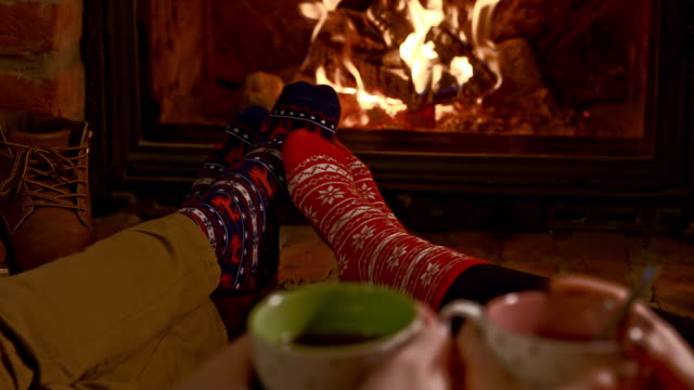 ds r/f romantic couple having hot tea by the fireplace - human foot stock videos and b-roll footage