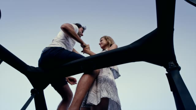 Romantic couple hugging in sun roof. Viewpoint