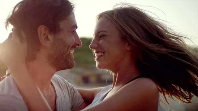 romantic couple hugging on the beach - falling in love stock videos and b-roll footage