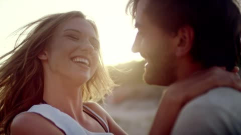 romantic couple hugging on the beach - emotion stock videos & royalty-free footage