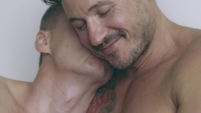 romantic couple in bed. - comportamento sessuale umano video stock e b–roll