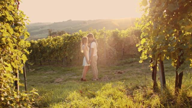 slo mo romantic couple in the vineyard - prekmurje stock videos & royalty-free footage
