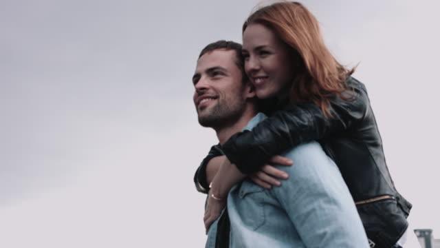 vídeos de stock, filmes e b-roll de romantic couple on rooftop - overcast