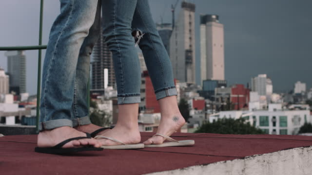 romantic couple on rooftop - flip flop stock videos and b-roll footage