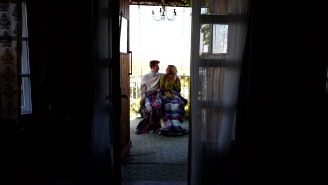 romantic couple swinging on a porch swing - porch stock videos & royalty-free footage