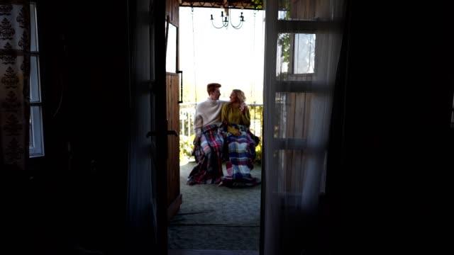 romantic couple swinging on a porch swing - veranda stock videos & royalty-free footage