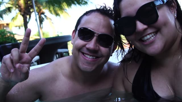 Romantic Couple Taking a Selfie at hot tub