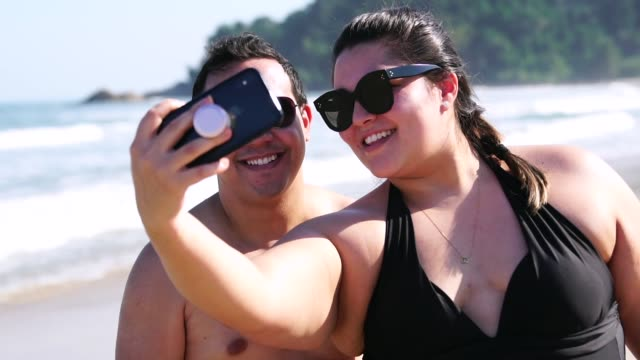 Romantic Couple Taking a Selfie on the beach