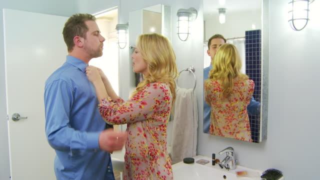 vídeos de stock, filmes e b-roll de romantic couple tying tie - shirt and tie
