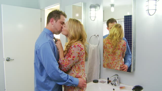 stockvideo's en b-roll-footage met romantic couple tying tie - menselijk haar