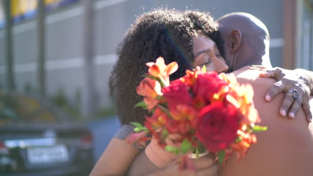romantic couple with flowers embracing - anniversary stock videos & royalty-free footage