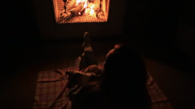 Romantic date of a couple in love in the countryside with old house and fireplace during winter in the Catalan Pyrenees spending the Christmas time vacations.
