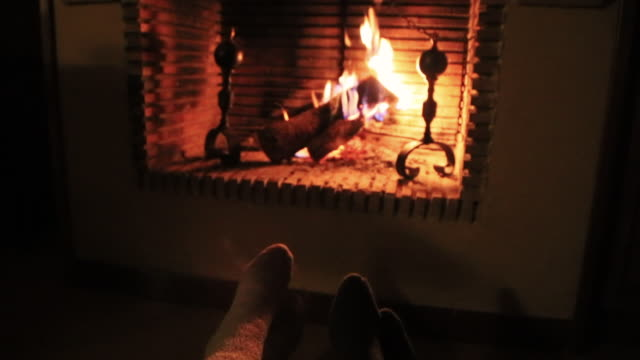 romantic date of a couple in love in the countryside with old house and fireplace during winter in the catalan pyrenees spending the christmas time vacations. - fireplace stock videos and b-roll footage