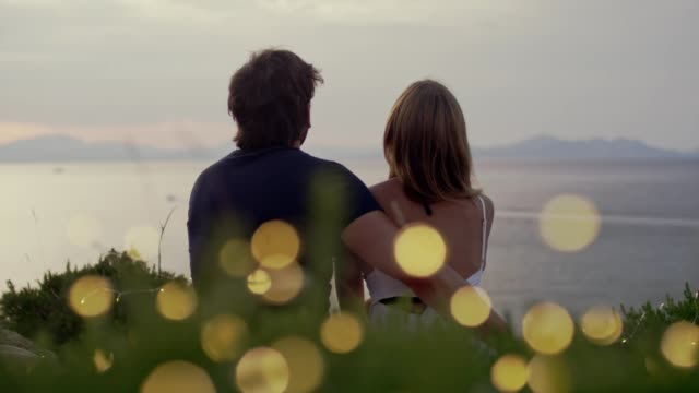 romantic date on a cliff. waiting for sunset - short phrase stock videos & royalty-free footage