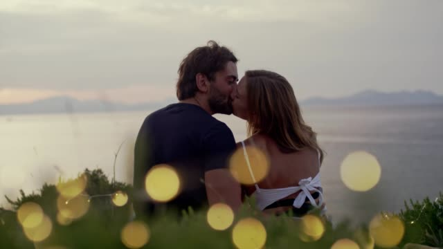 romantic date on a cliff. waiting for sunset - kissing stock videos & royalty-free footage