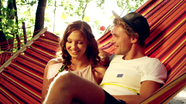 romantic date on the hammock. drinking tropical drinks - hammock stock videos & royalty-free footage