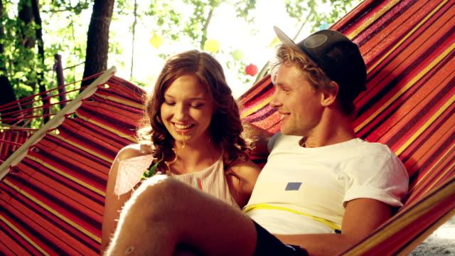 romantic date on the hammock. drinking tropical drinks - hammock stock videos & royalty-free footage