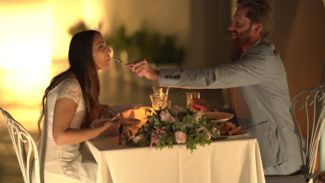 romantic dinner couple eating