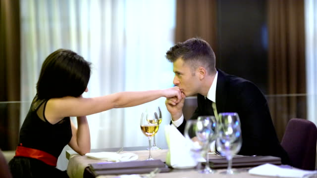 romantic dinner - kissing hand stock videos & royalty-free footage