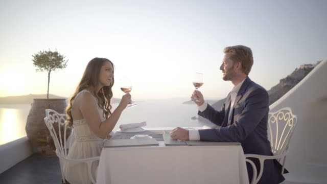 romantic evening couple table for two terrace sunset - お食事デート点の映像素材/bロール