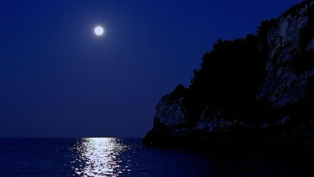 Romantic fullmoon at night on Cala Romantica on Spanish Balearic island of Majorca / Spain