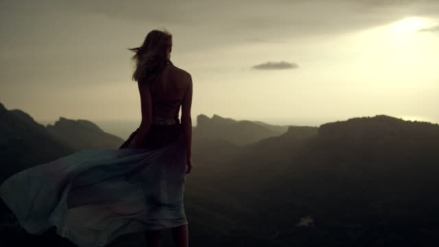 romantic girl in long dress enjoying the wind. looking at view from a cliff - cliff stock videos & royalty-free footage