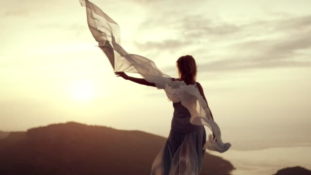 romantic girl in long dress enjoying the wind. standing on a cliff - silk stock videos & royalty-free footage