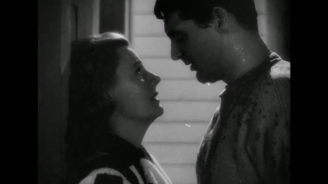1941 A romantic kiss on the beach at night between man (Cary Grant) and woman (Irene Dunne)