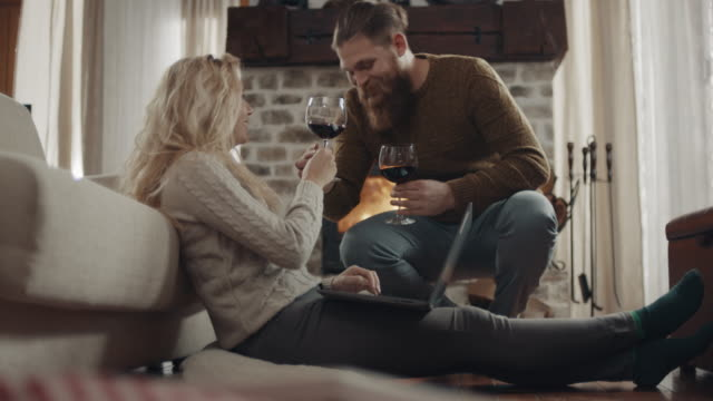 romantic man surprise hardworking girlfriend with glass of wine - warming up stock videos & royalty-free footage