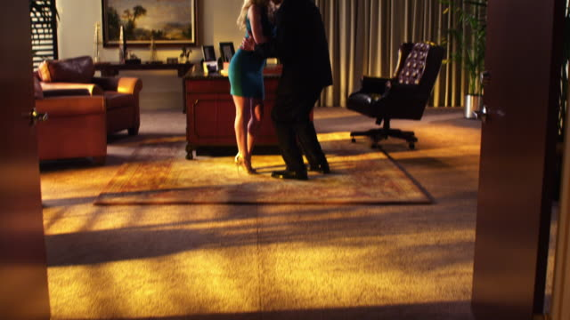 romantic office couple - infidelity stock videos & royalty-free footage