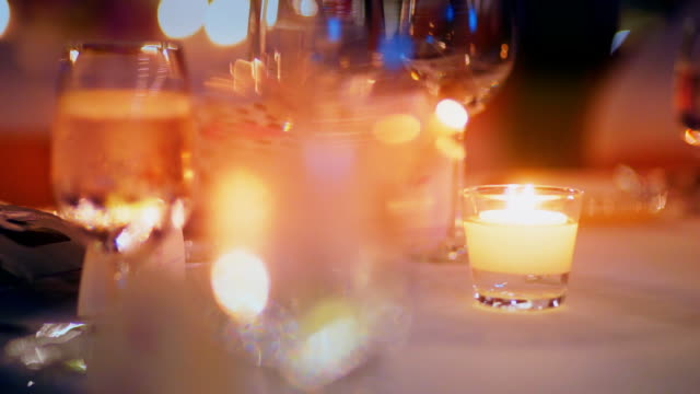 romantic outdoor wedding table with flower arrangement and candles. - flower arrangement stock videos & royalty-free footage