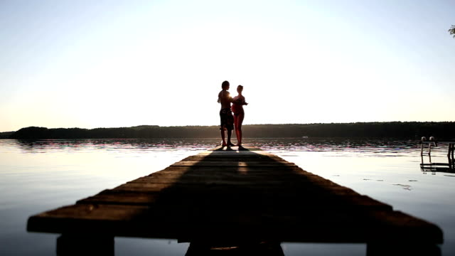romantic pair during sunset - hot passionate kissing stock videos & royalty-free footage