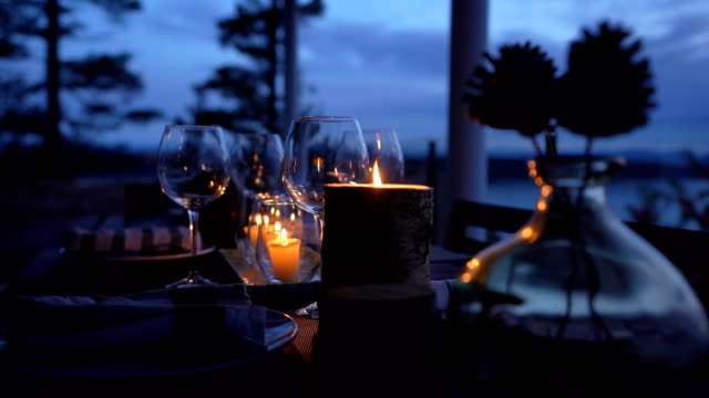 romantic seaside restaurant at sunset - dining table stock videos & royalty-free footage