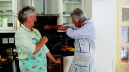 Romantic senior couple dancing in kitchen 4k