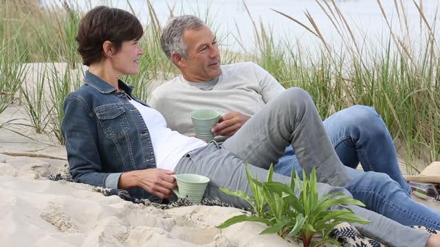romantic senior couple on beach - 50 54 years stock videos & royalty-free footage